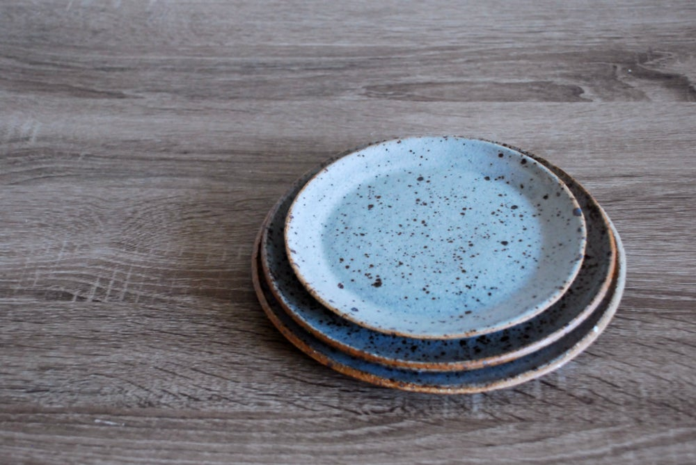 Image of plates, speckled blue