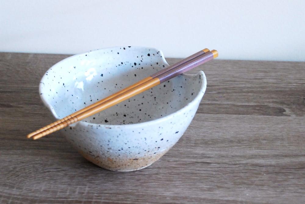 Image of laksa bowl, speckled white