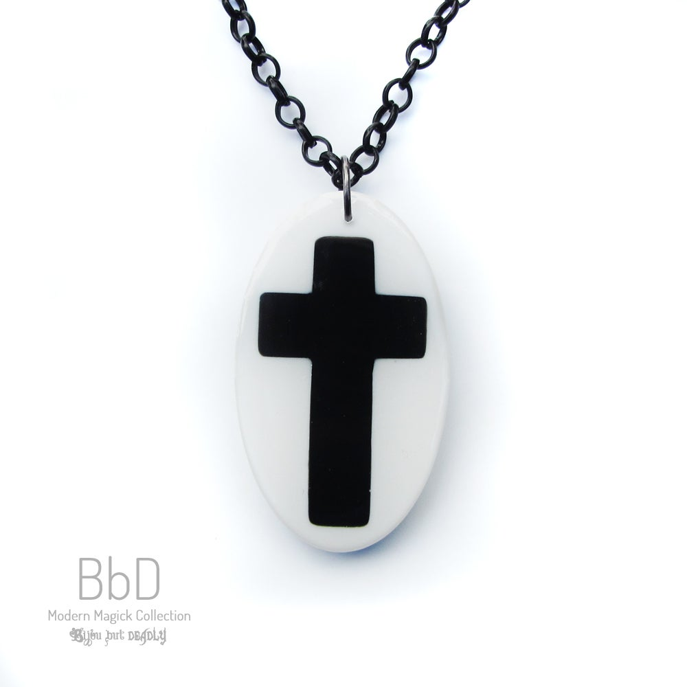 Oval Crucifix Resin Pendant