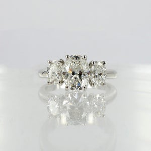 Image of 18ct White Gold Oval Diamond Trilogy Ring