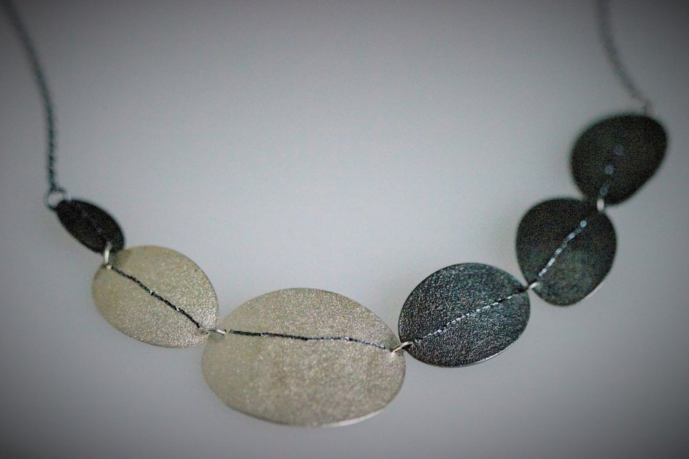 Image of Sewn Up Large 6 disc necklace