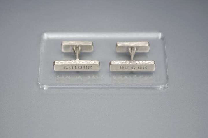 Image of silver cufflinks with Latin inscription