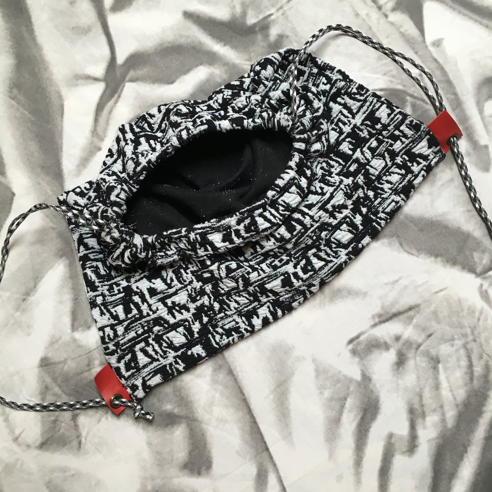 Image of BLACK WHITE AND RED ALL OVER DRAWSTRING BACKPACK