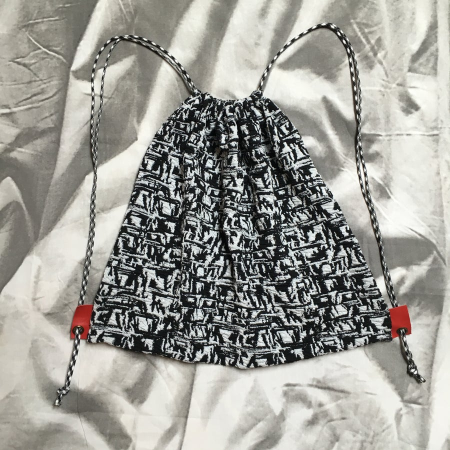 Image of Black White and Red All-Over Drawstring Backpack