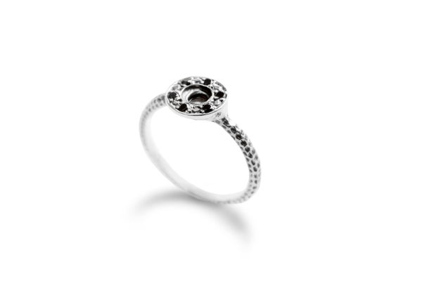 Image of Puka ring with black spinels