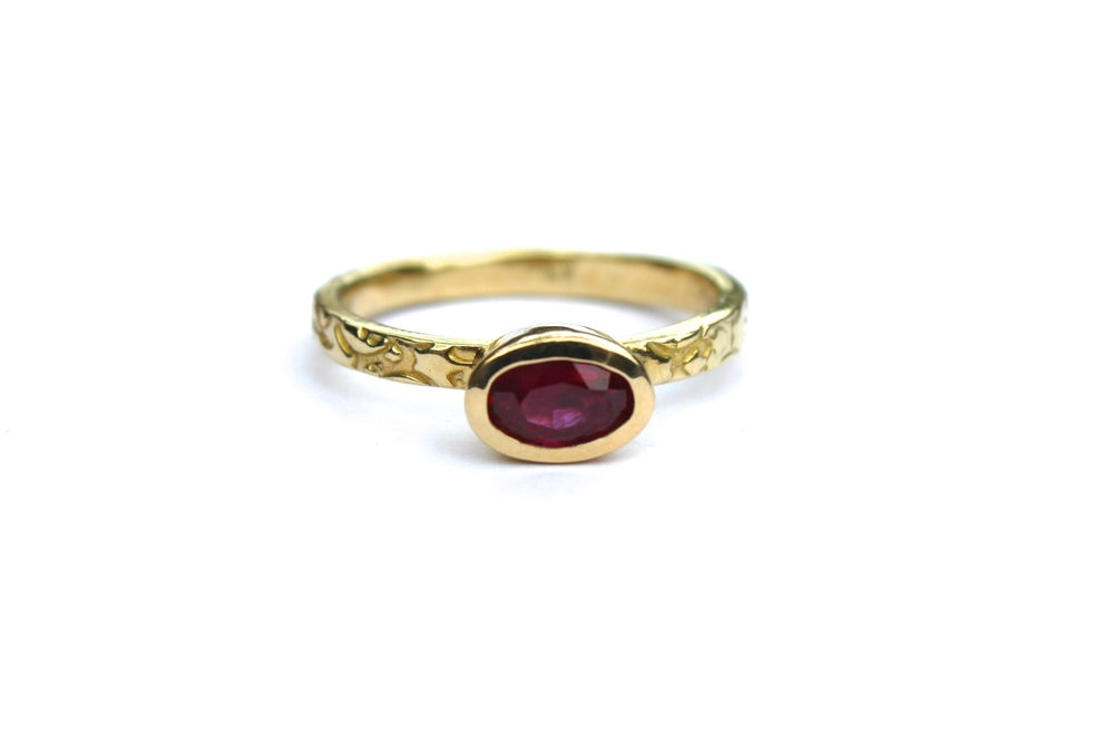 Image of 18k yellow gold ruby engagement ring with engraved rose band