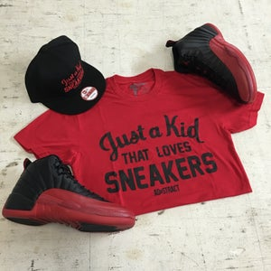 "Image of JUST A KID THAT LOVES SNEAKERS ""RED"" TSHIRT (MENS)"