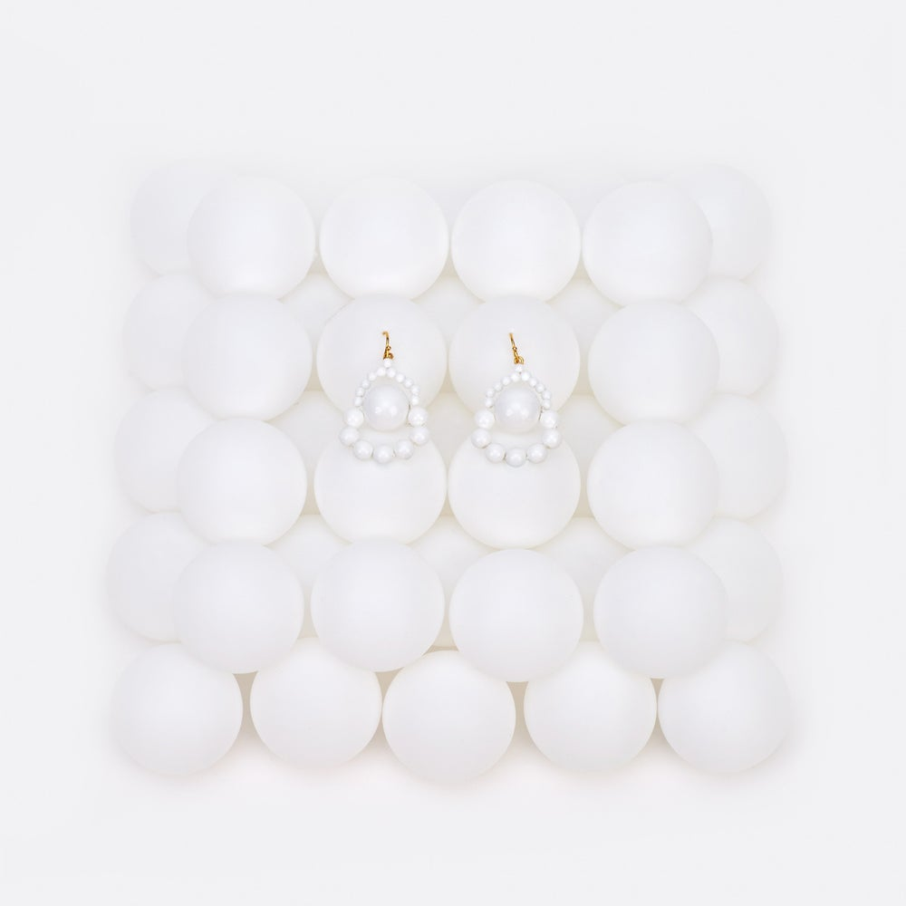 Image of White loop a loop earrings