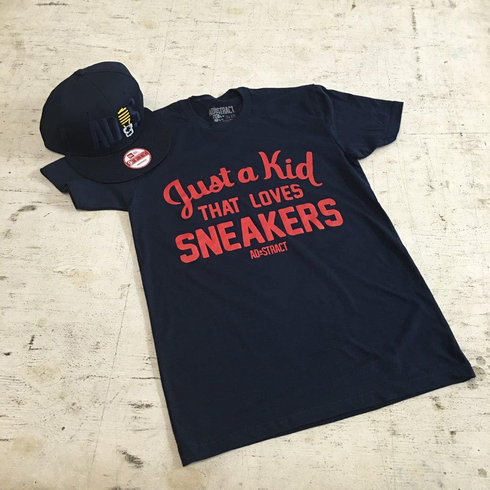"Image of JUST A KID THAT LOVES SNEAKERS ""NAVY/RED"" TSHIRT"