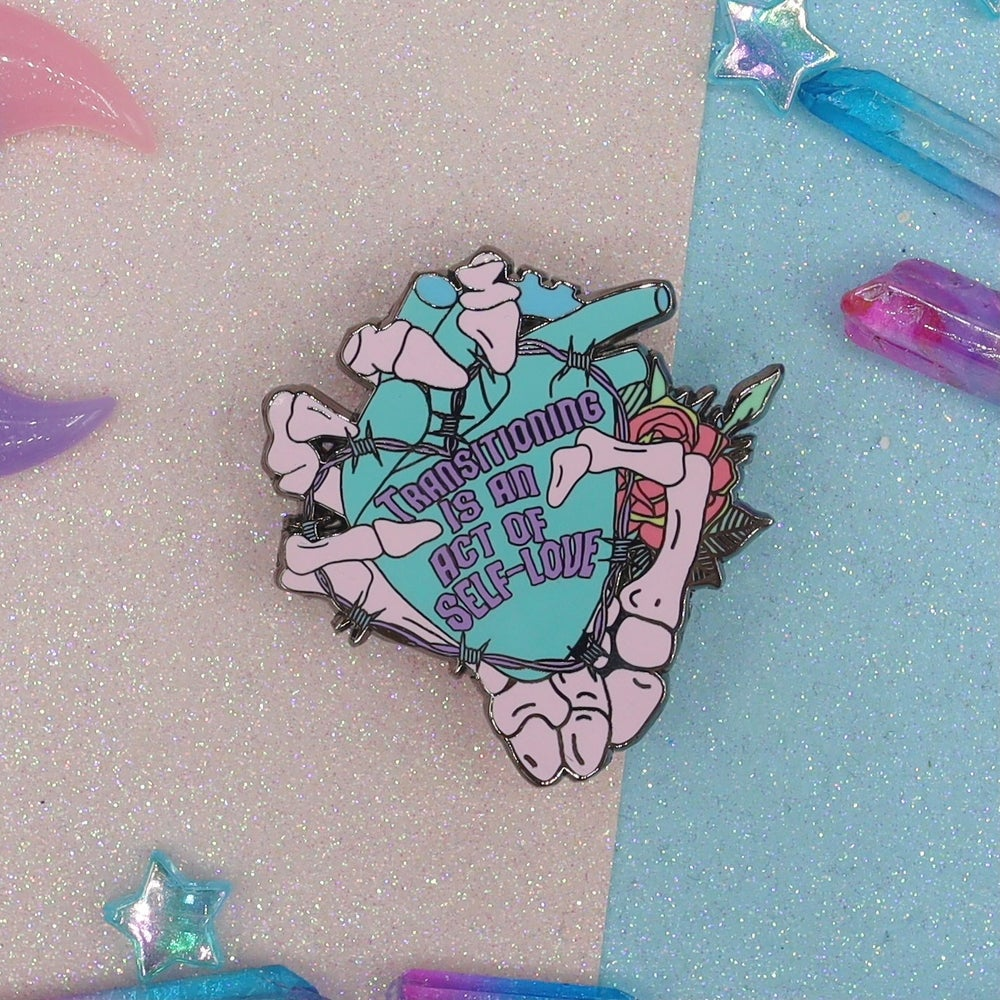 Image of Transitioning Is An Act Of Self Love Enamel Pin