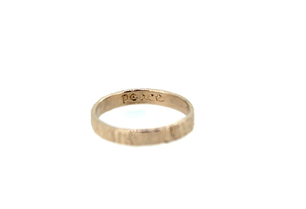 Image of rose gold woodgrain wedding band