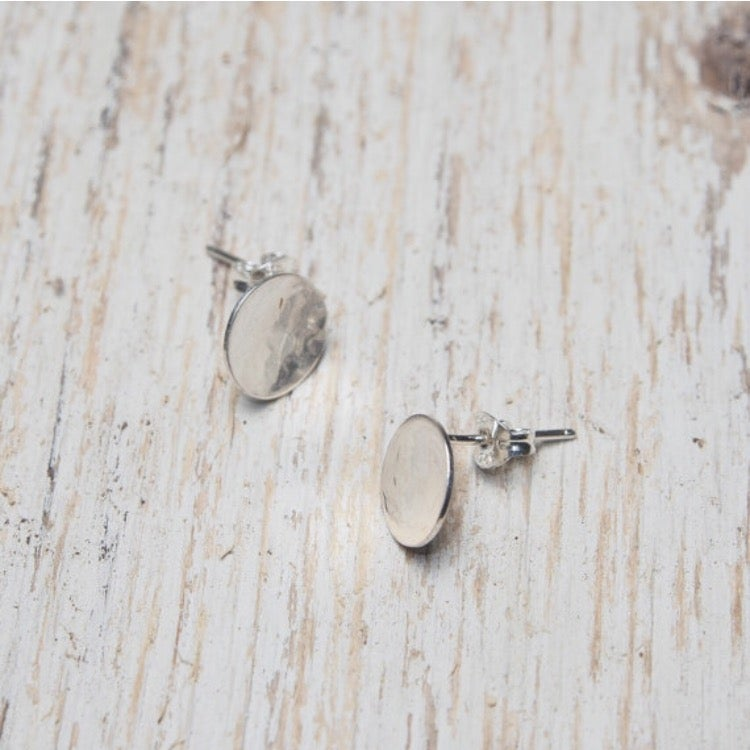 Image of small hammered full moon studs