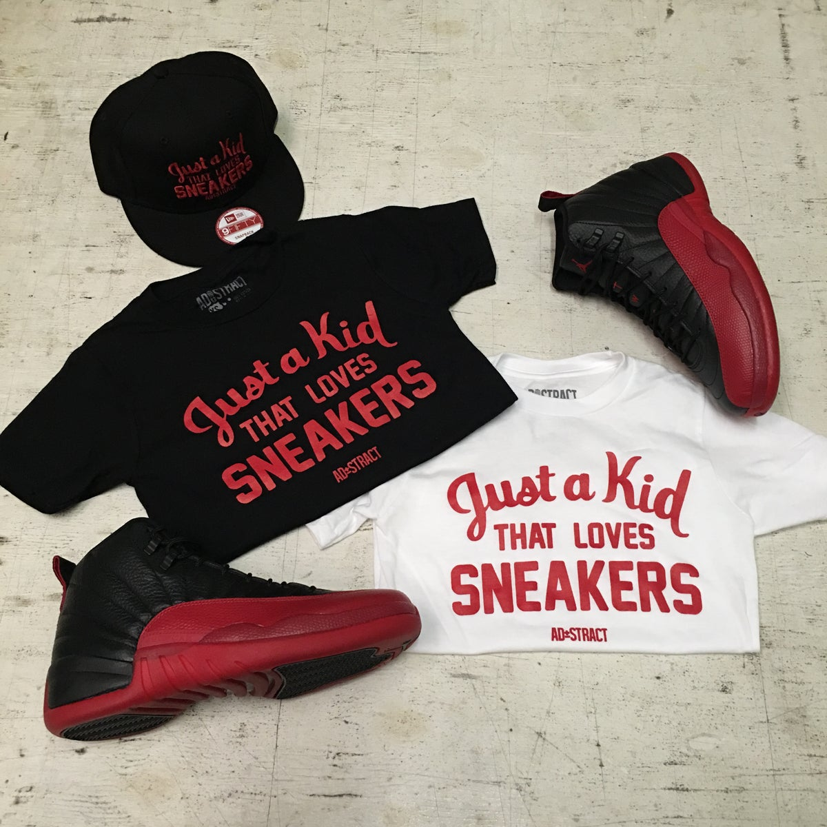 "Image of JUST A KID THAT LOVES SNEAKERS T-SHIRT "" RED PRINT "" (YOUTH)"