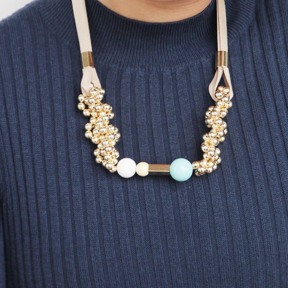 Image of Gold blowing up pendent necklace