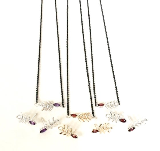 Image of Garnet Eye Silver Fish Necklace