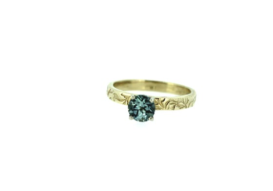 Image of Montana sapphire engagement ring . 14k yellow gold