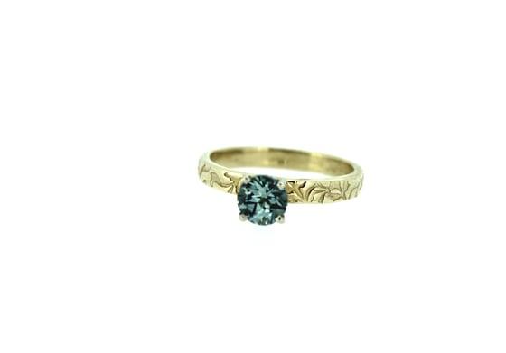 Image of Montana sapphire engagement ring . 14k yellow gold