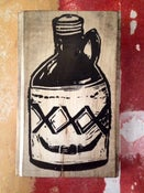 Image of Jug (on found wood)