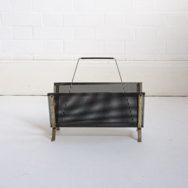 Image of Black metal and brass magazine rack, c 1950