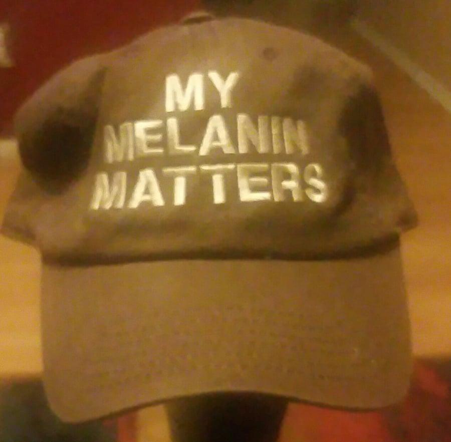Image of MY MELANIN MATTERS BROWN/WHITE DAD HAT