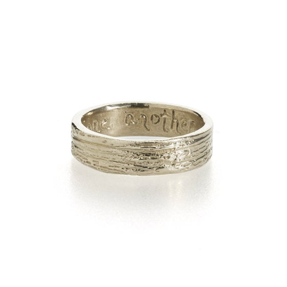 Image of woodgrain wedding band . 14k gold