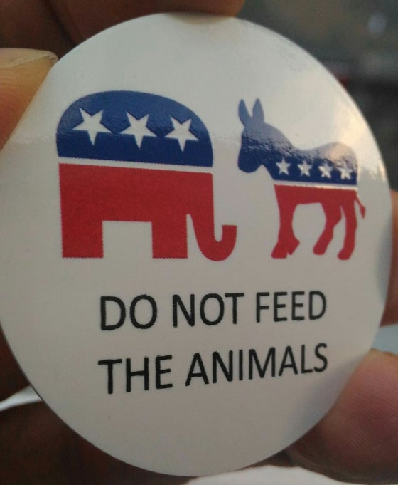 Image of DO NOT FEED THE ANIMALS round vinyl color sticker