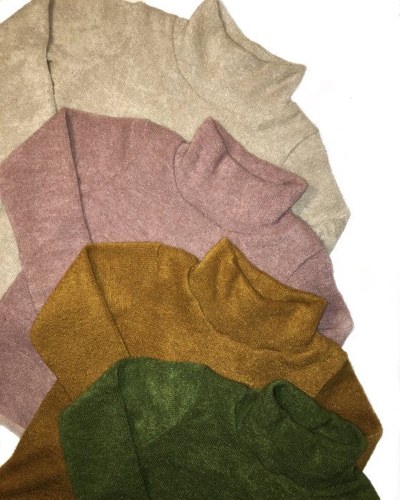 Image of Roll neck jumpers