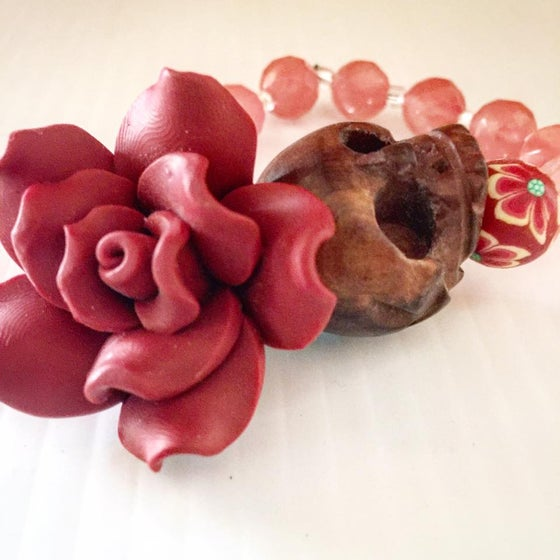 Image of Dia De Los Muertos~Wood Carved Skull with Cherry Quartz