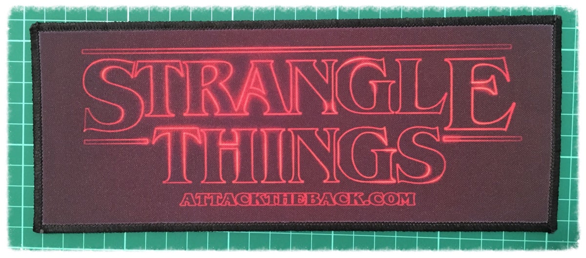 """Image of Attack The Back """"Strangle Things"""" Patch"""