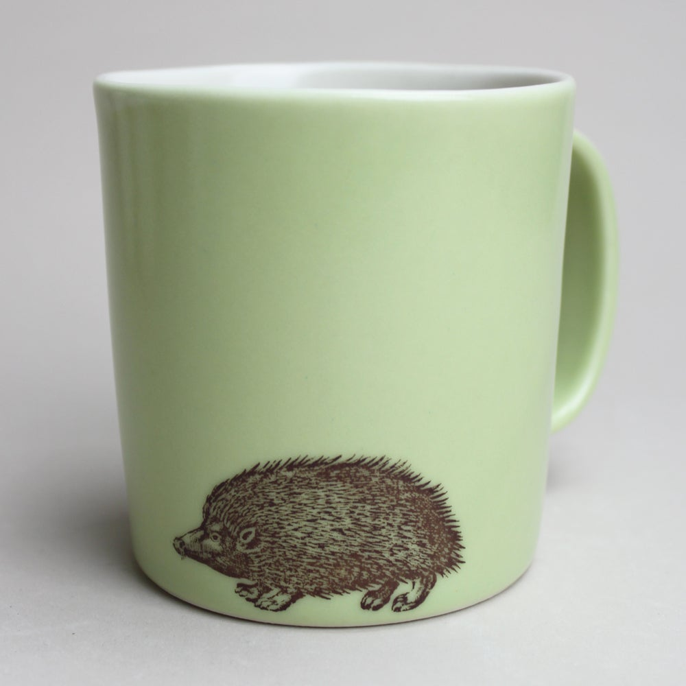 Image of 16oz mug with hedgehog, avocado