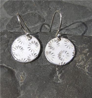 Image of Silver circle star earrings