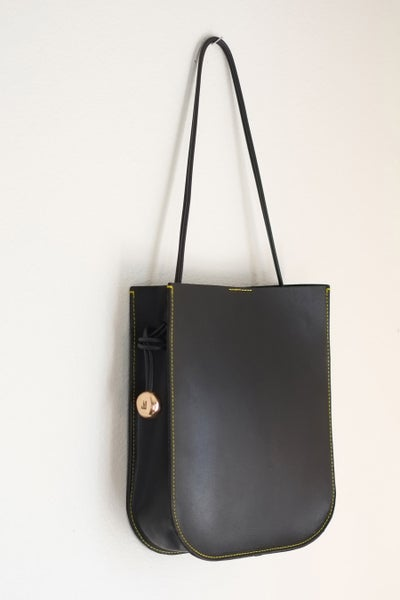Image of black paddle bag
