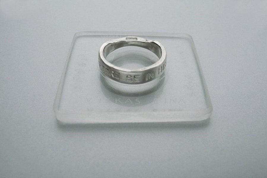 Image of silver classical rings with inscription in Latin