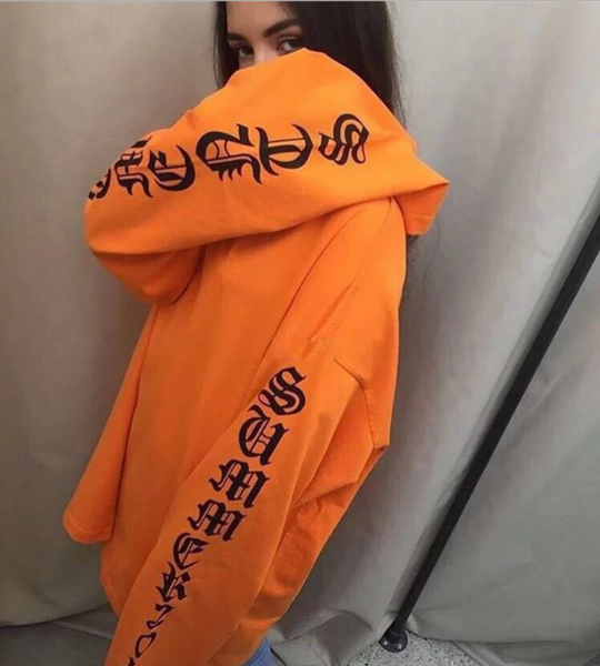 Image of Giant letters printed long section of the sleeve loose circle couple models orange wool sweater