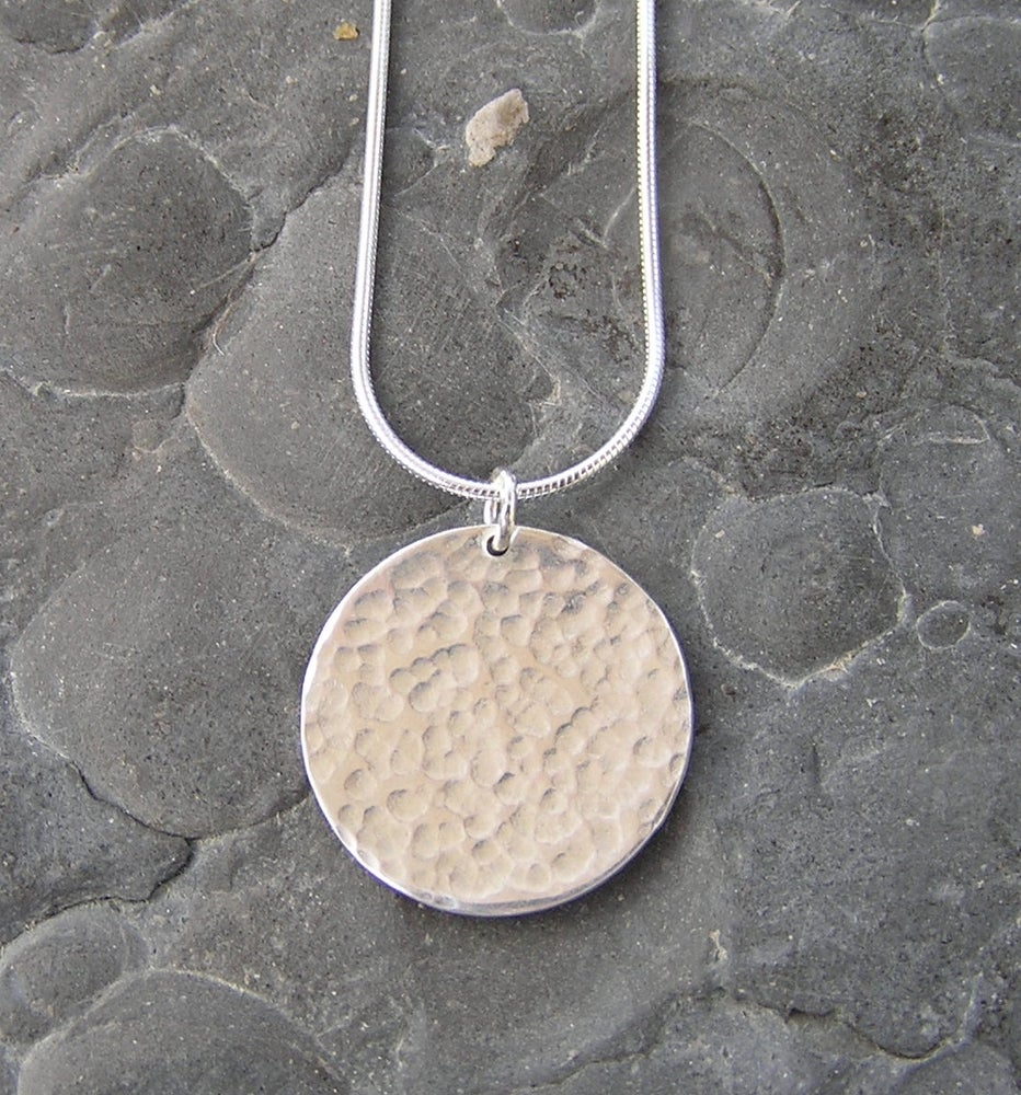 Image of Silver circle hammered pendant