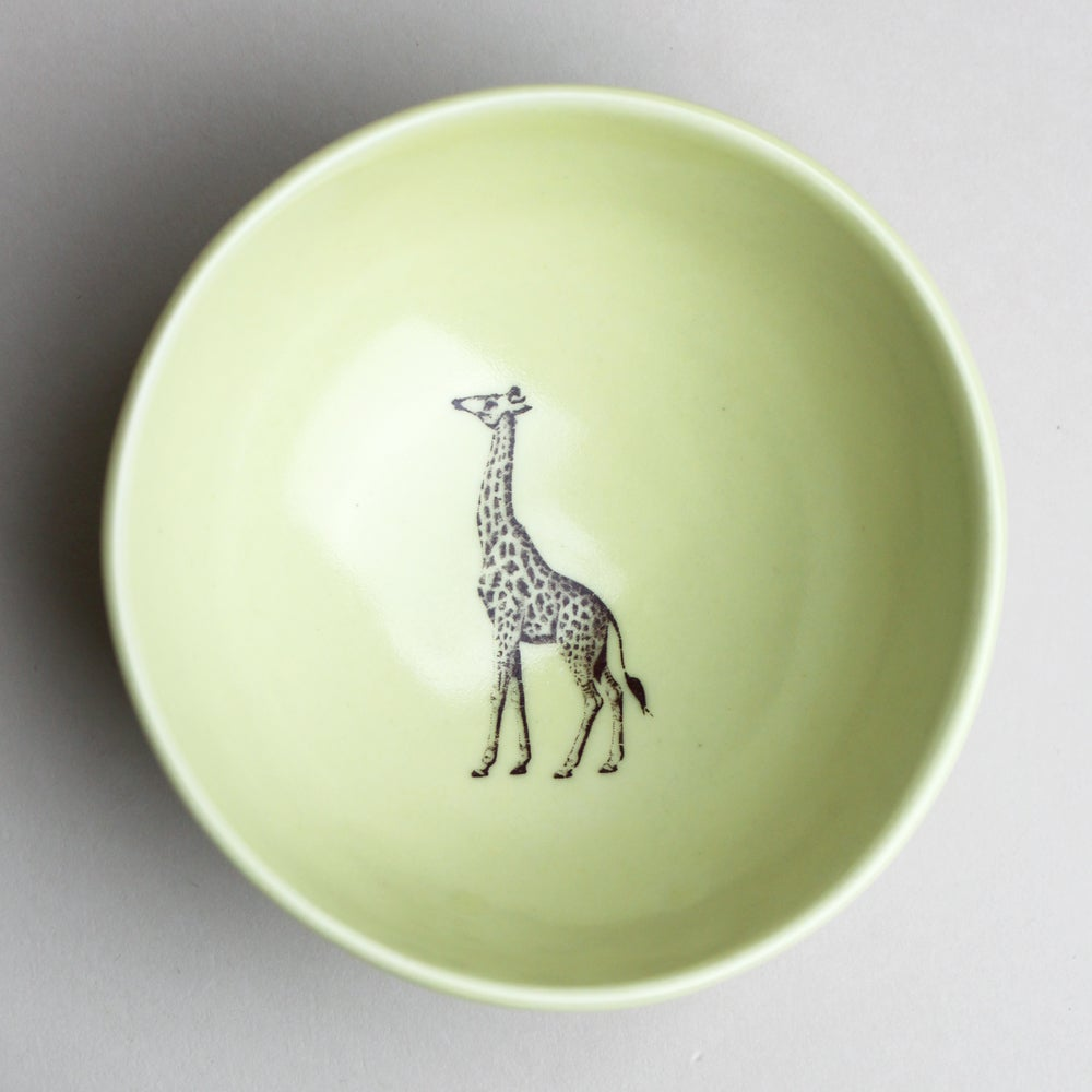 Image of roly poly bowl with giraffe, mustard