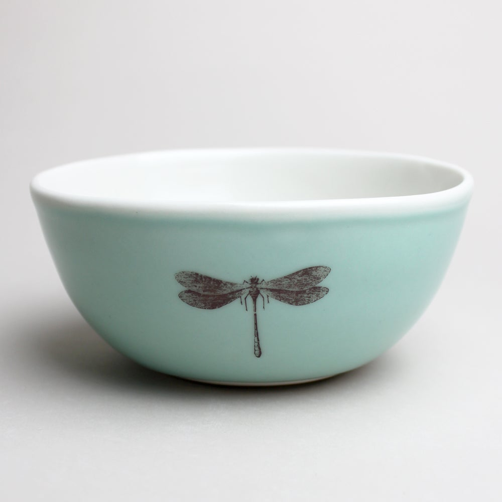 Image of rustic bowl with dragonfly, aqua