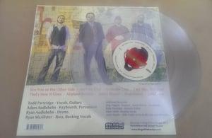 Image of Cumplir con el Diablo - Clear Vinyl LP with Lyric Sheet Insert