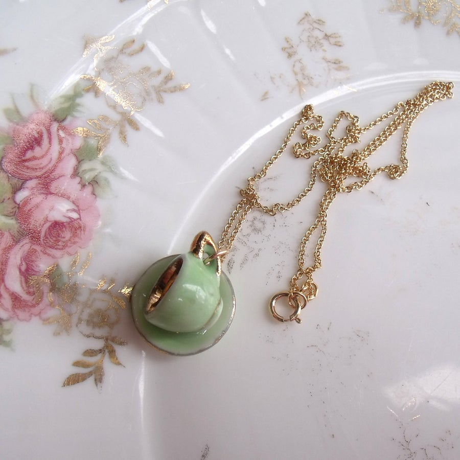 Image of green cup and saucer necklace
