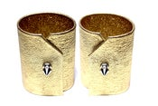 Image of Gold leather cuffs