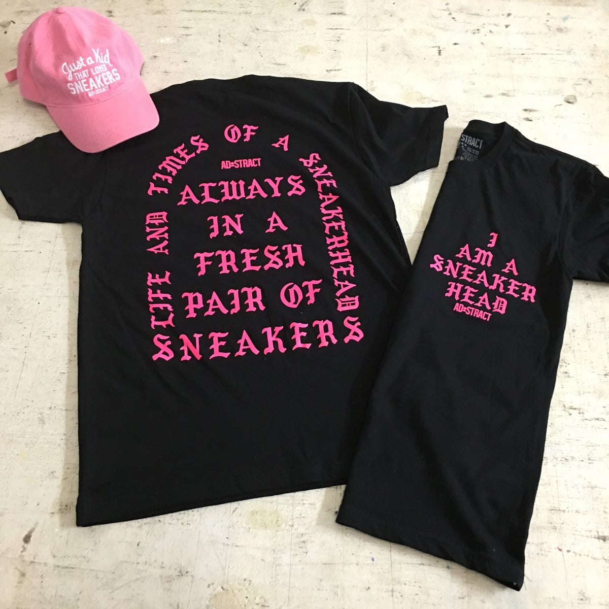 Image of I AM A SNEAKERHEAD (BLACK OR WHITE W/ PINK PRINT) T-SHIRT