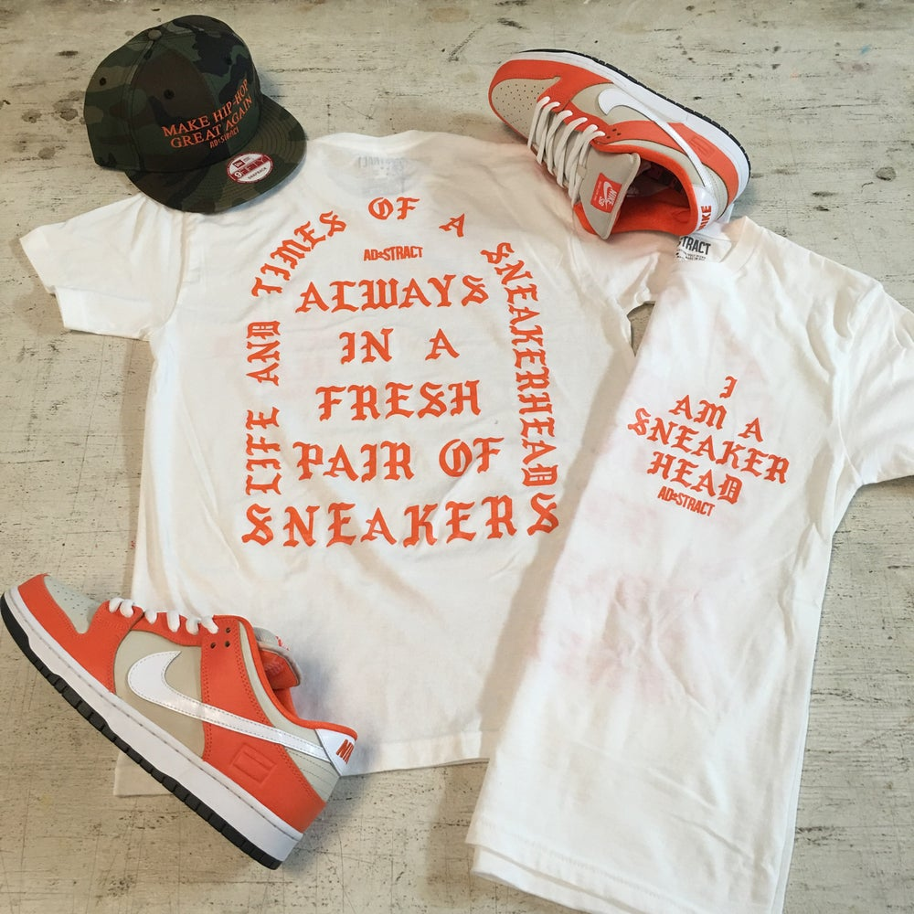 "Image of I AM A SNEAKERHEAD ""WHITE OR BLACK W/ ORANGE PRINT"" T-SHIRT OR HOODY"