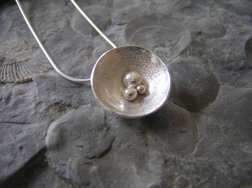 Image of Silver pebble domed pendant