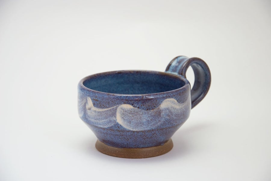 Image of blue soup mug with slip decoration