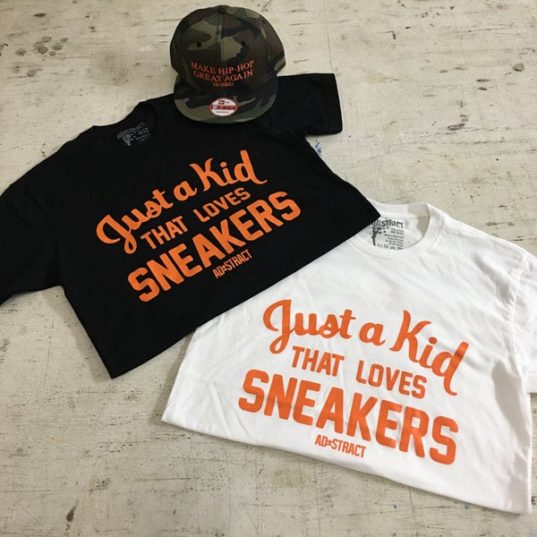 "Image of JUST A KID THAT LOVES SNEAKERS ""ORANGE PRINT"" T-SHIRT"