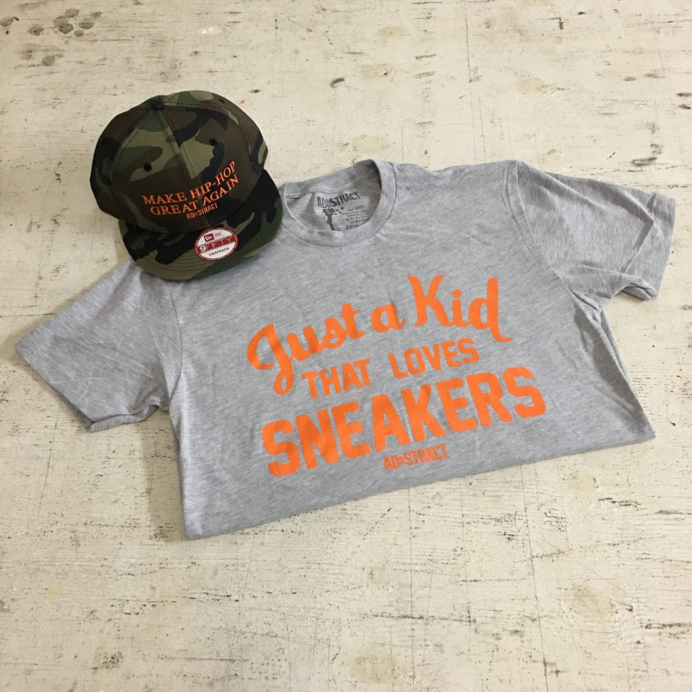 "Image of JUST A KID THAT LOVES SNEAKERS ""GREY/ORANGE"" TSHIRT & HOODY (MENS)"