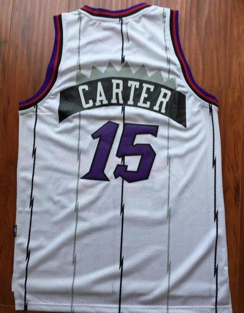"Image of PURPLE PINSTRIPED RAPTORS ""CARTER"" #15 BASKETBALL THROWBACK JERSEY"