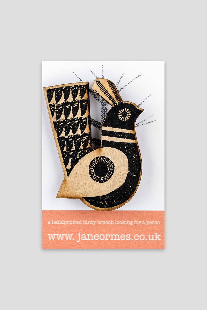 Image of Black circled winged handprinted wooden quail brooch
