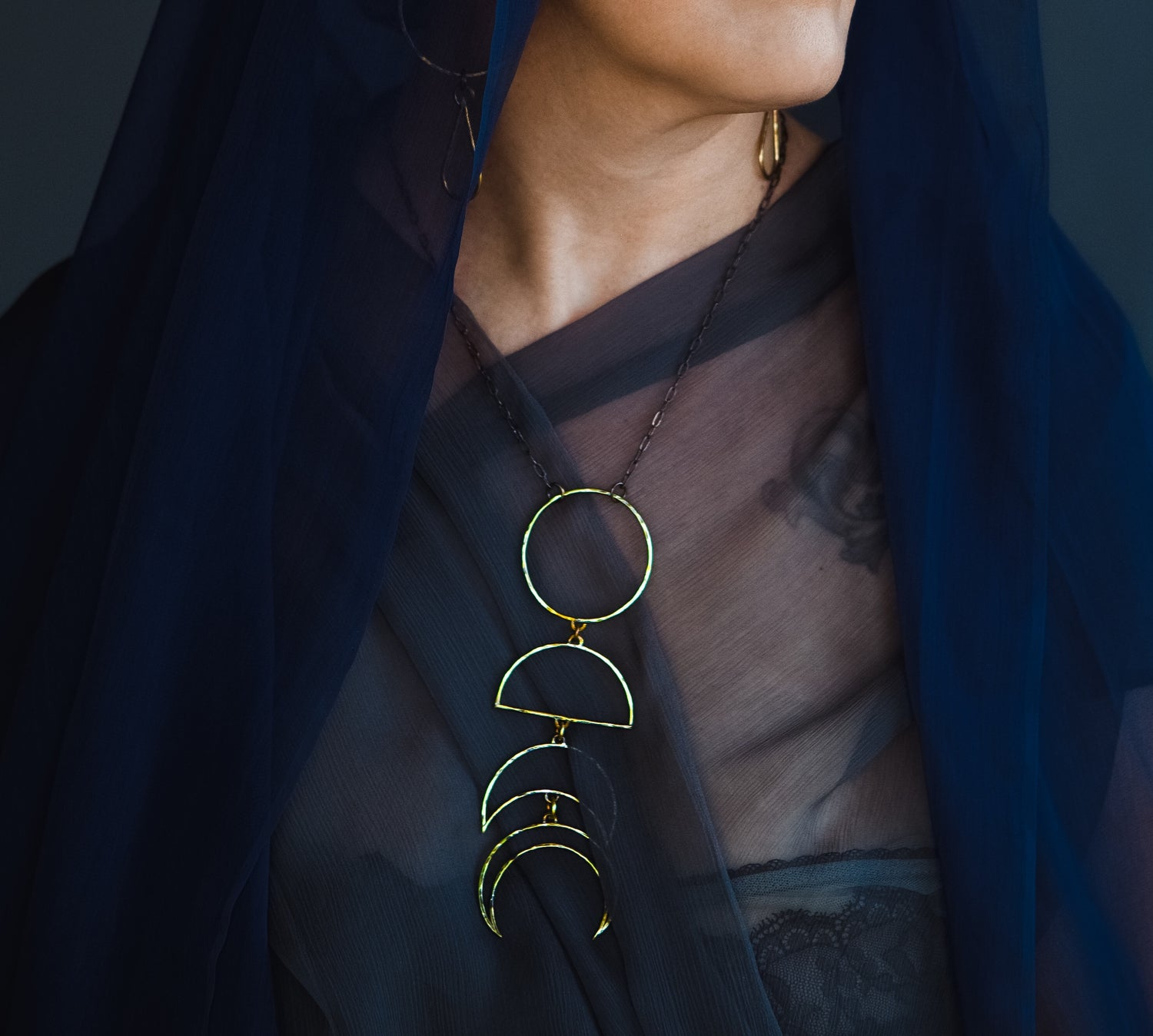 Image of Fortnight Moon phase necklace, brass in stock