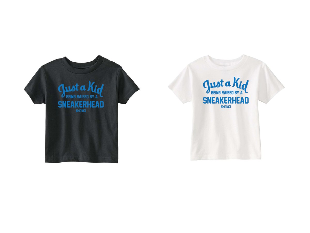 """Image of JUST A KID BEING RASIED BY A SNEAKERHEAD """"ROYAL BLUE"""" (TODDLERS TEE)"""